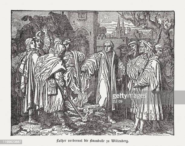 luther burns the papal bull at wittenberg (1520), published 1883 - lutherstadt wittenberg stock illustrations