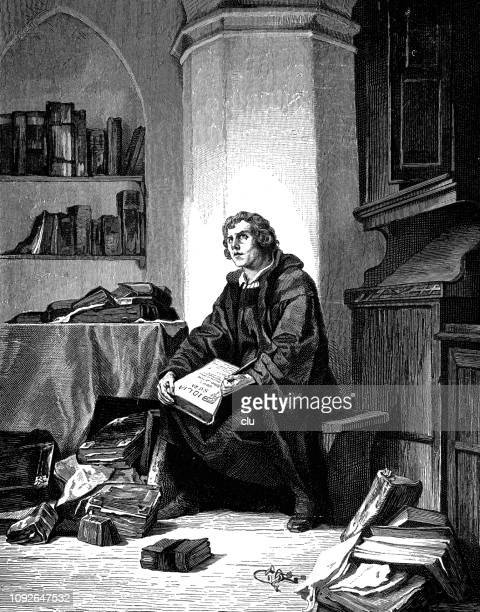 luther holds an open bible, sitting in his library - protestantism stock illustrations