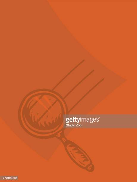 A magnifying glass against an orange background