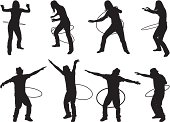 Male and female silhouettes playing with hula hoops