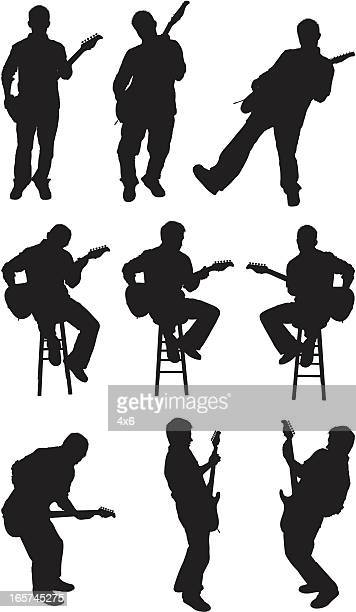 male guitarist performing and rocking out - guitarist stock illustrations, clip art, cartoons, & icons