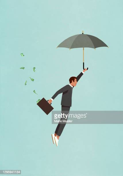male investor with umbrella and money briefcase flying - safety stock illustrations