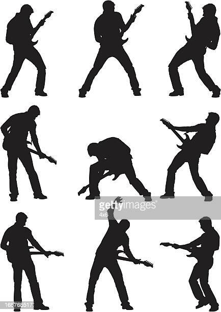 male silhouettes rocking out on guitar - guitarist stock illustrations, clip art, cartoons, & icons