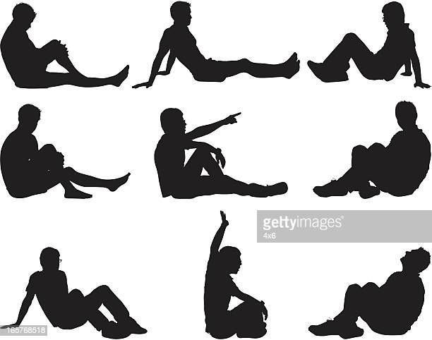 Male silhouettes sitting on ground