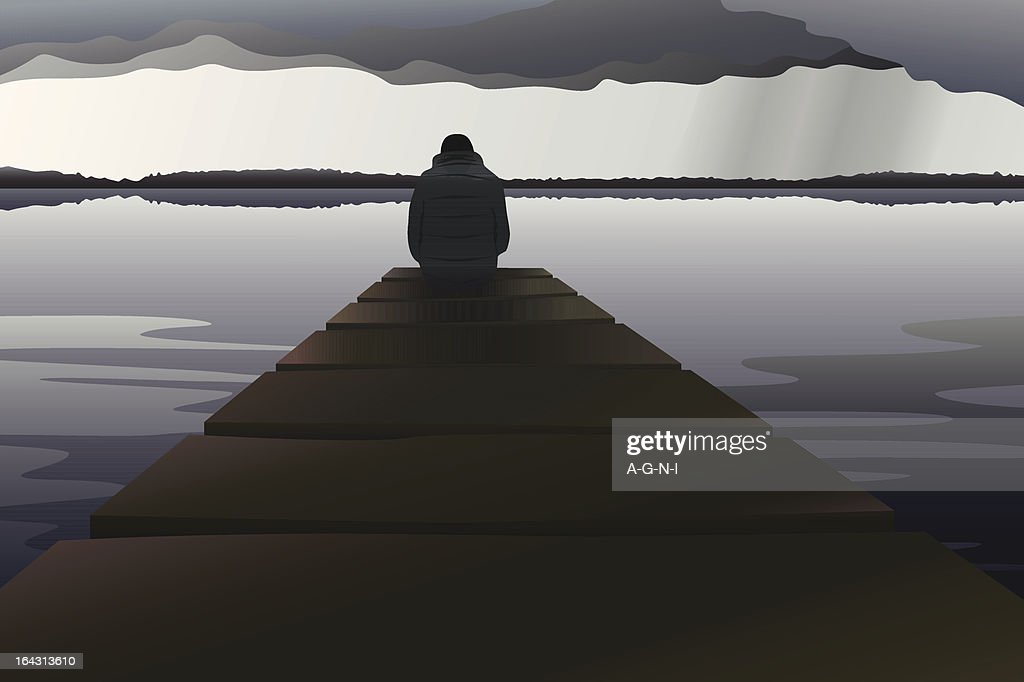 Man alone at the lake