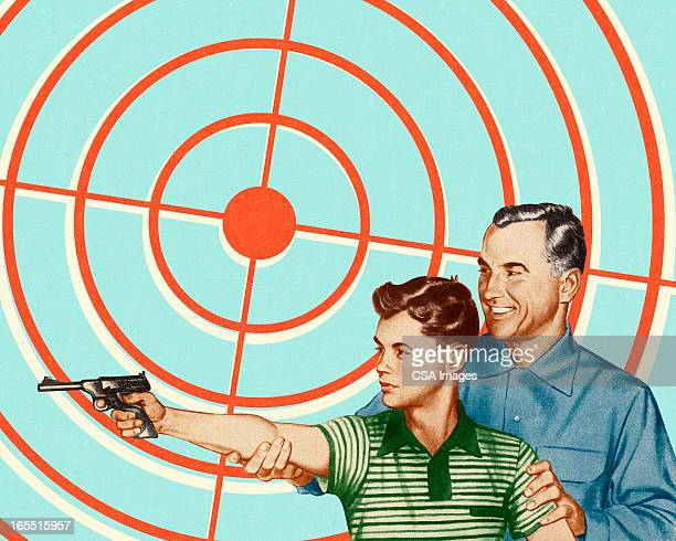 Man and Boy Shooting a Gun