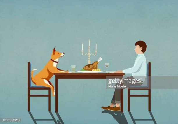 man and dog enjoying candlelight dinner at table - food and drink stock illustrations