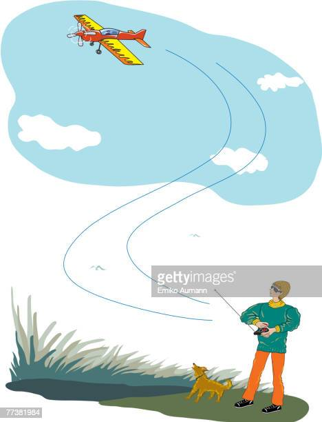 A Man and his pet trying to fly a toy airplane