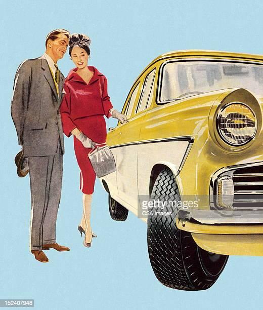 Man and Woman Admiring Car