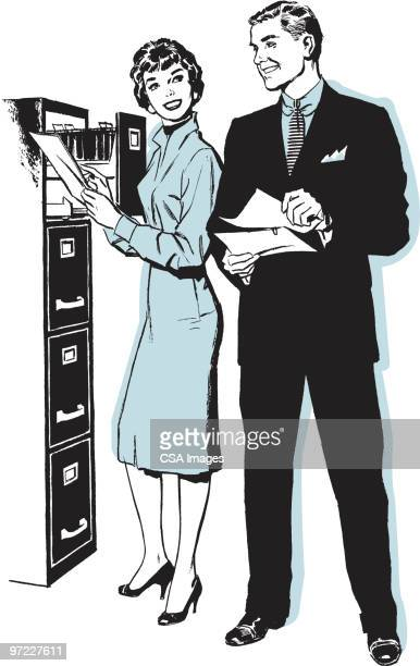 Man and Woman at File Drawer