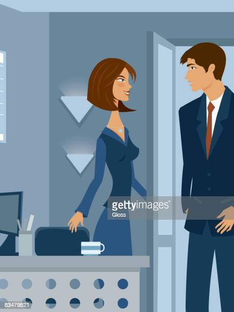 A man and woman chatting at the office
