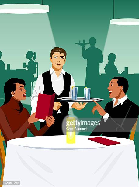 Man and woman ordering food in restaurant