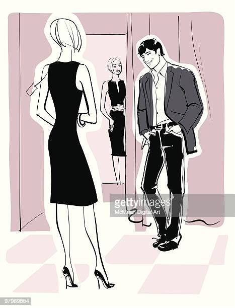 Man and woman shopping, woman trying on dress