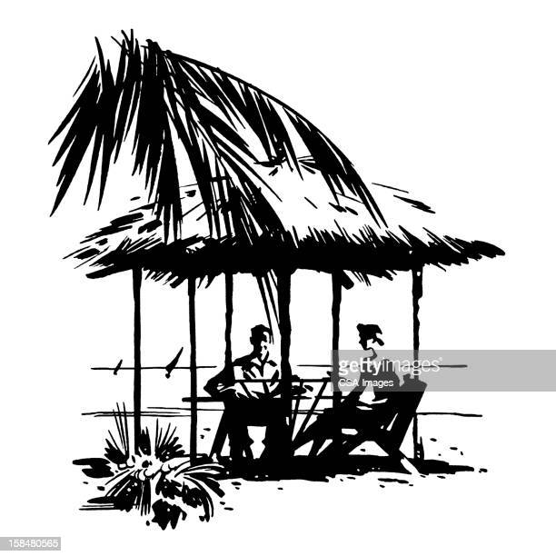 Man and Woman Sitting Under Hut