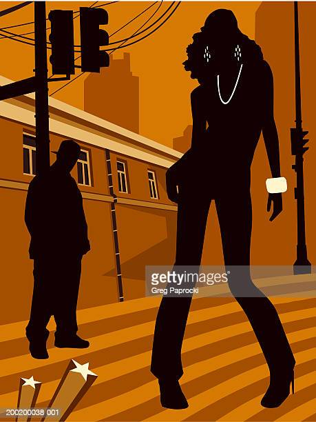 man and woman standing on urban street, silhouette - high street stock illustrations