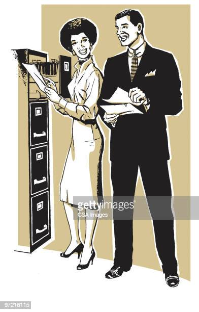 Man and Woman Talking at Workplace File Cabinet