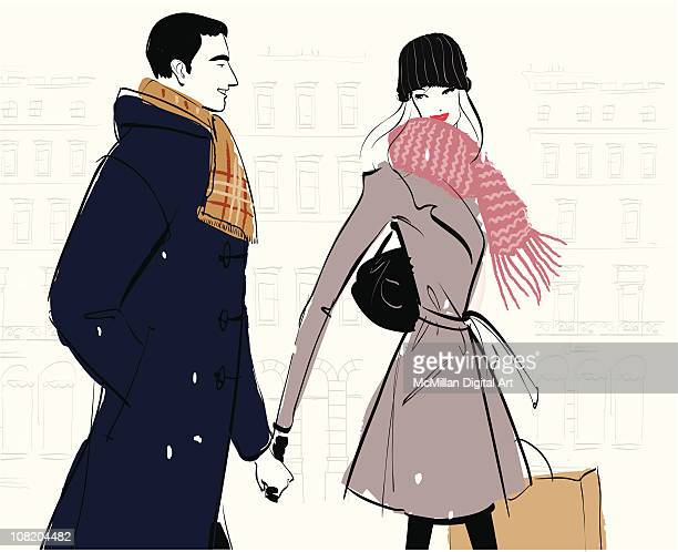 Man and woman walking in snow, holding hands