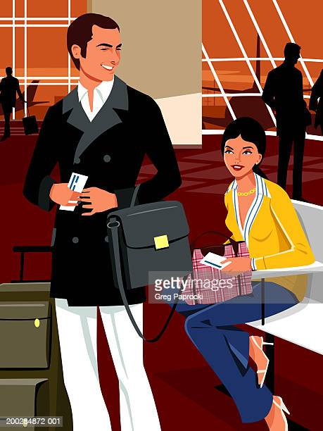 Man and woman with luggage and tickets in airport