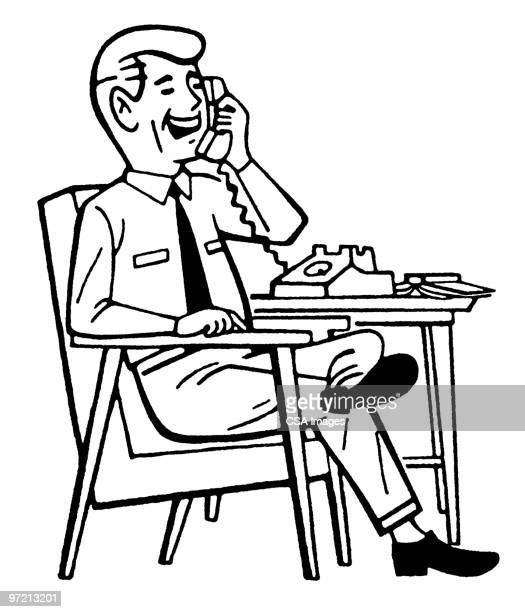 Man at Desk on Telephone