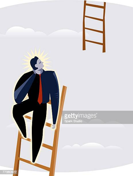 A man at the top of a ladder
