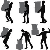 Man carrying stacks of boxes