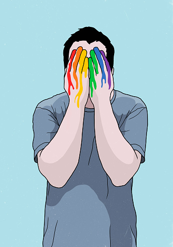 Man covering face with rainbow painted hands - gettyimageskorea