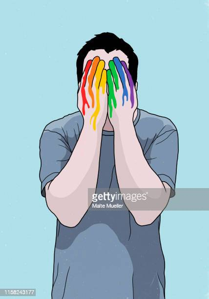 man covering face with rainbow painted hands - touching stock illustrations