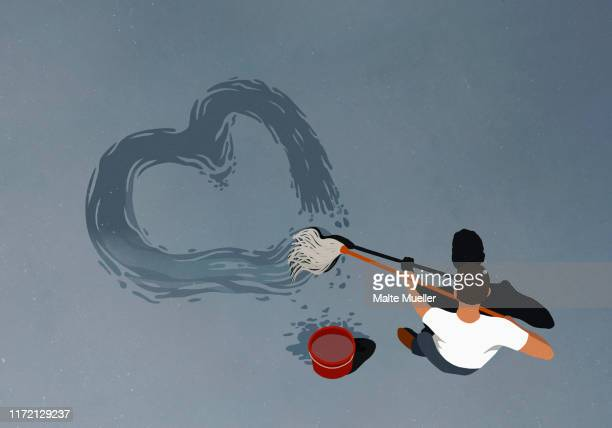 man drawing heart-shape with mop - one man only stock illustrations