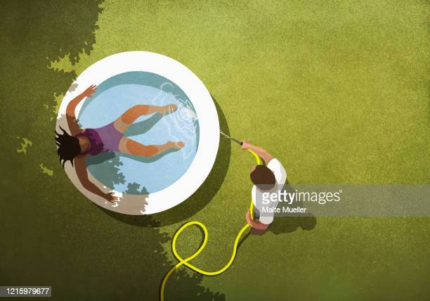 man filling wading pool with water for wife - outdoors stock illustrations