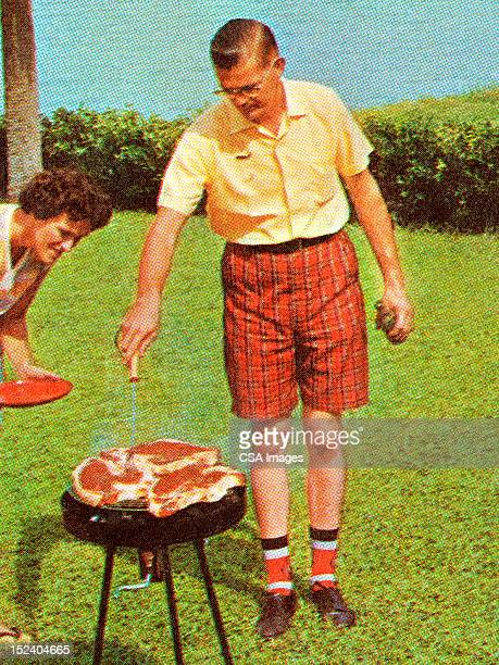 Man Grilling Steaks