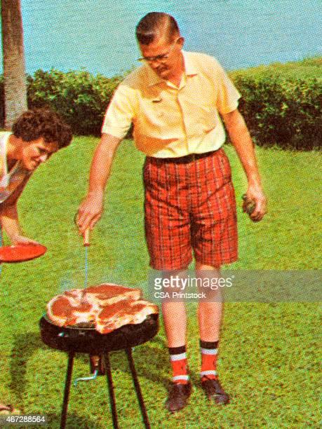 Man Grilling Steaks