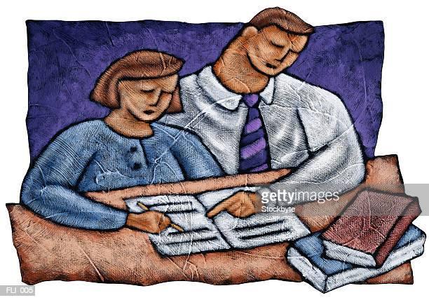 Man helping girl with homework