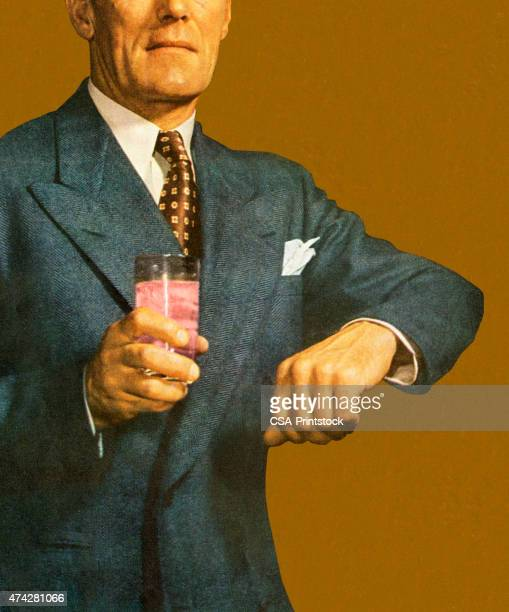 Man Holding Arm up and Holding Drink