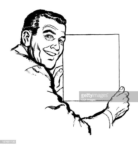 Homme tenant vide feuille de papier