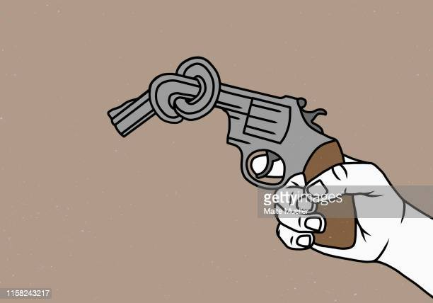 man holding knotted gun - unrecognisable person stock illustrations