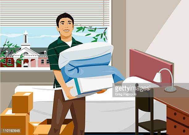 Man holding linens in dorm room