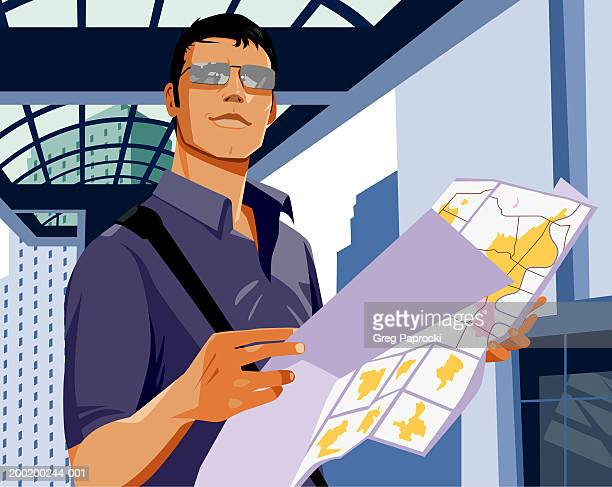man holding map - one young man only stock illustrations
