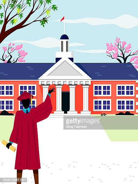 Man in cap and gown holding diploma and waving