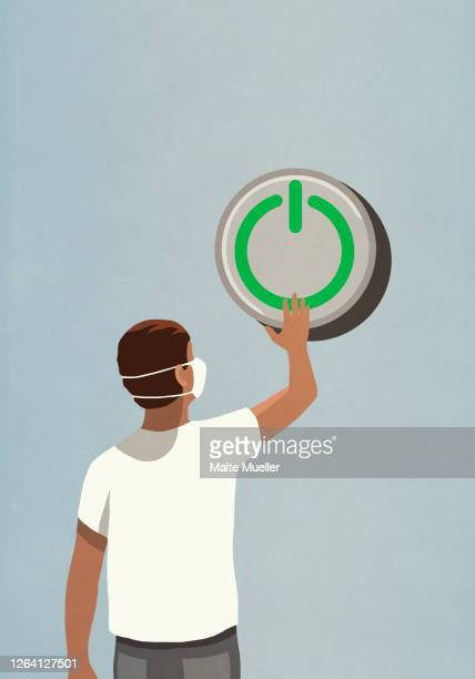 man in face mask pushing large green power on button - safety stock illustrations