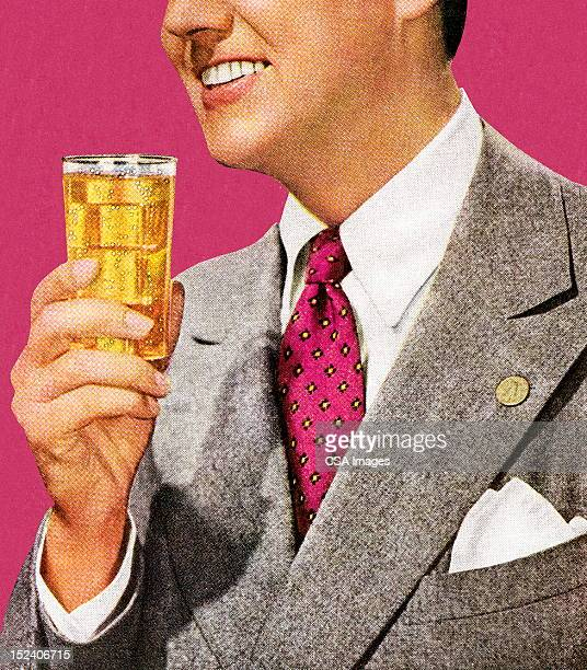 Man in Grey Suit Holding Drink