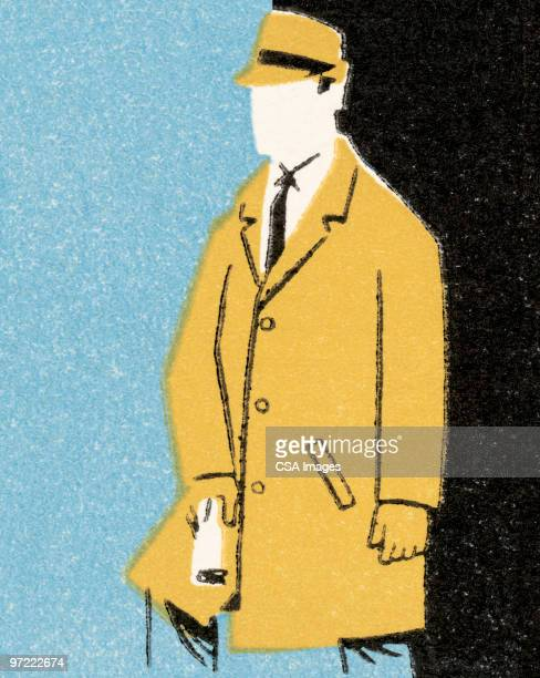Man in overcoat and hat