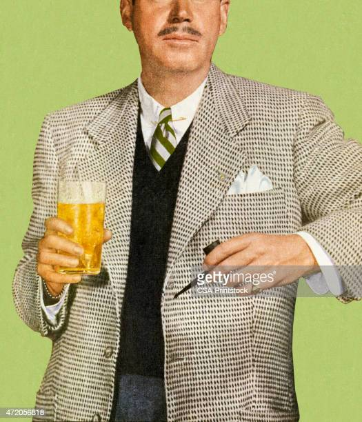 Man in Suit Holding Beverage