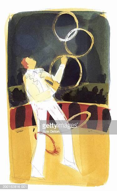 Man juggling hoops at circus