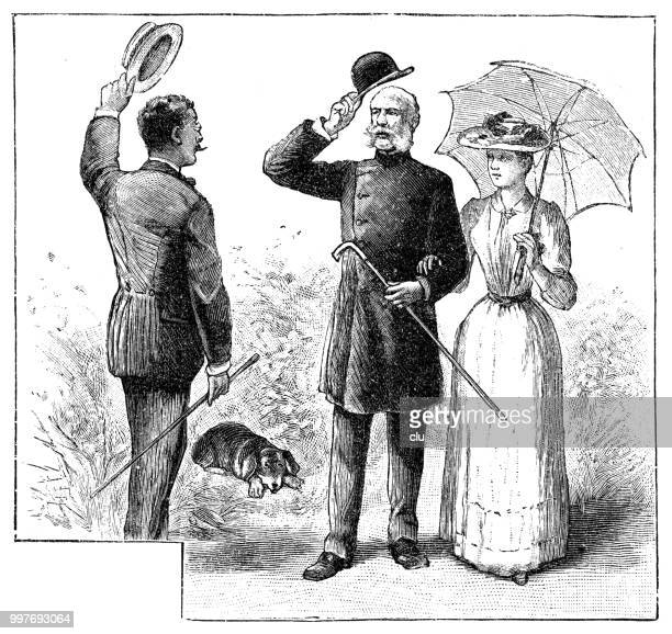 Man lifts his hat and greets a couple on a summer walk