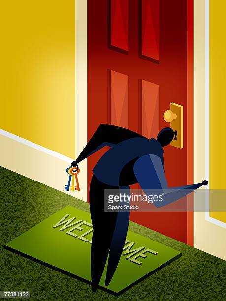 A man looking through a key hole