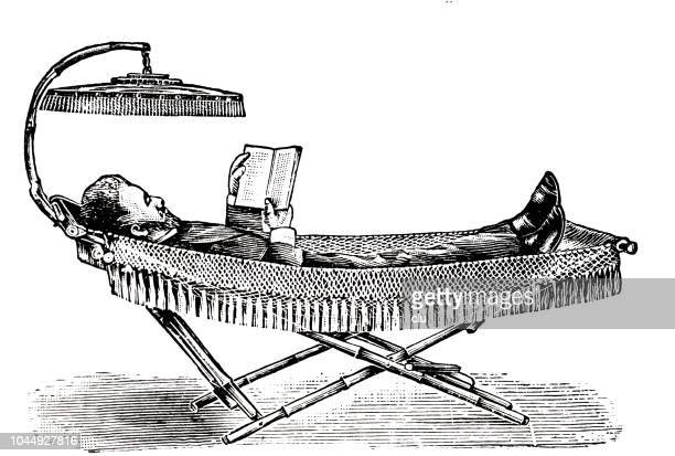 man lying on camping bed, reading a book with a sun shade above - bed furniture stock illustrations