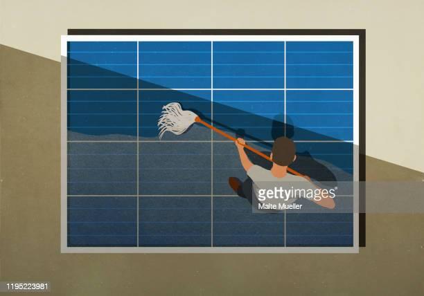 man mopping solar panels - hingabe stock-grafiken, -clipart, -cartoons und -symbole