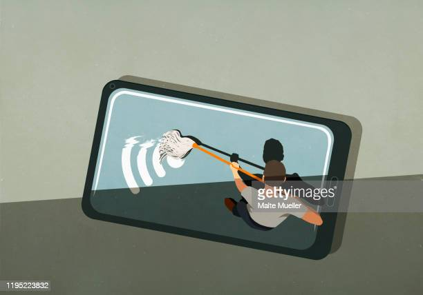 man mopping wifi symbol on smart phone screen - image technique stock illustrations