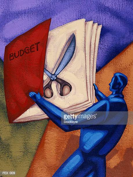 Man opening book marked BUDGET, with pair of scissors concealed inside