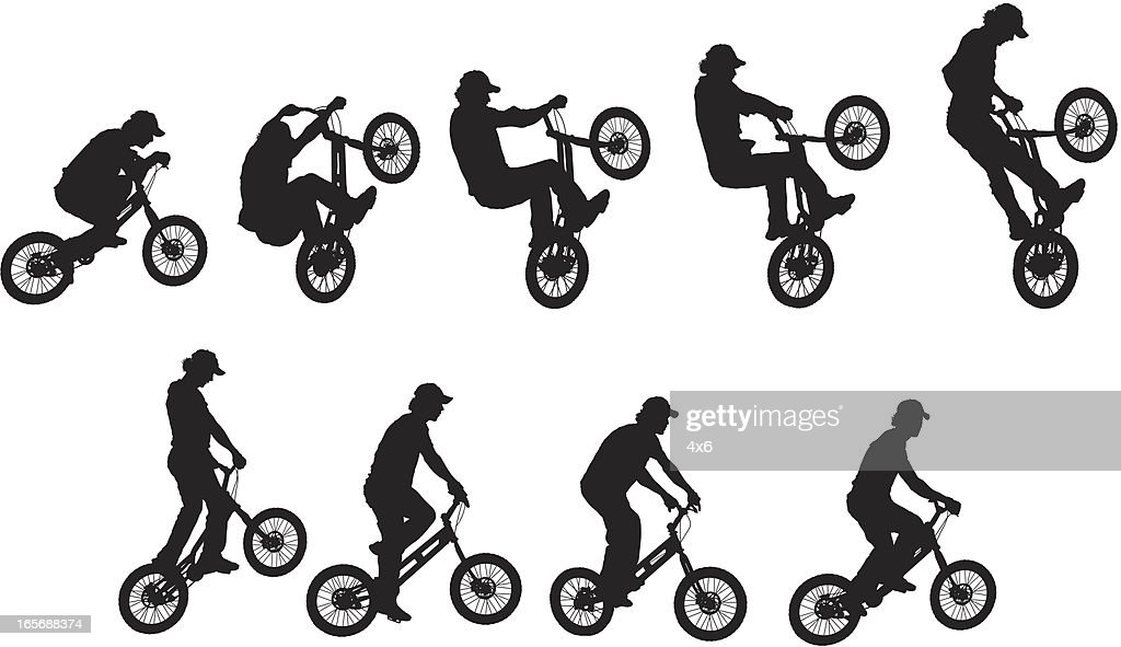 Man performing stunt on BMX bike